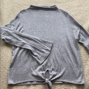 Grey sweater tie keyhole. Bell sleeves. Loose fit